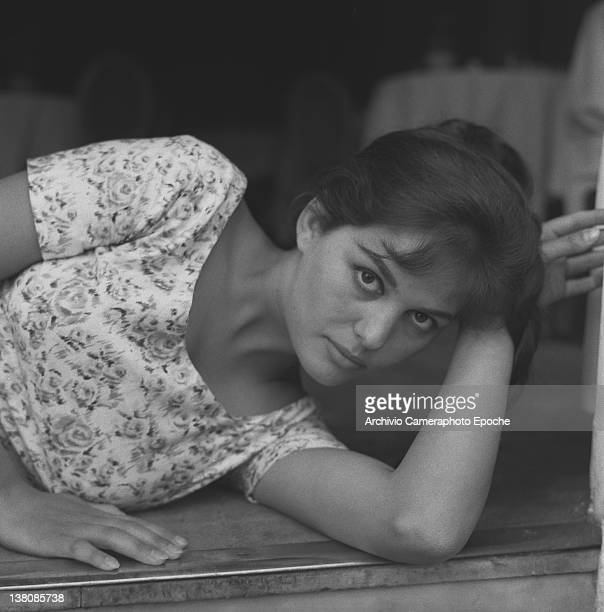 Italian actress Claudia Cardinale portrayed while lying on the floor wearing a plait and a floral dress Venice 1958