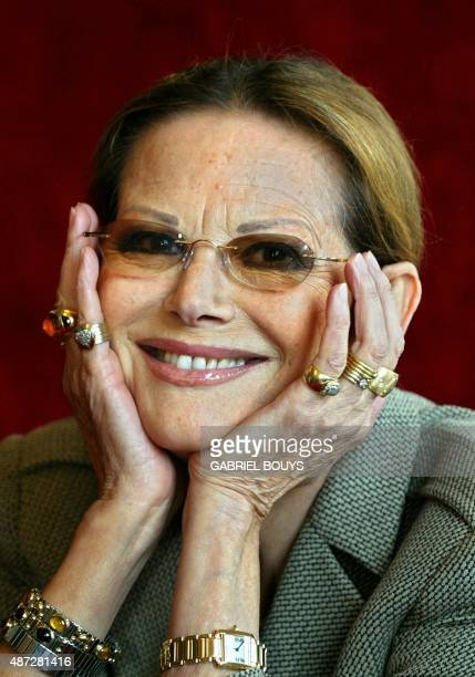 Italian actress Claudia Cardinale poses during a press conference 04 November 2002 in Rome to promote her first experience as theatre actress in Come...