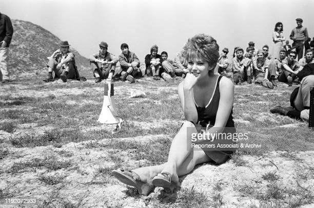 Italian actress Claudia Cardinale relaxing on the set of La Ragazza di Bube. Italy, 1963