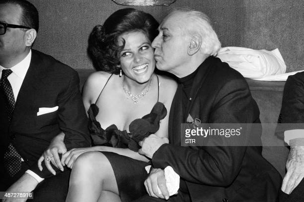 Italian actress Claudia Cardinale starring in the film 'The Magnificent Cuckold' of Antonio Pietrangeli attends the preview of the film with French...