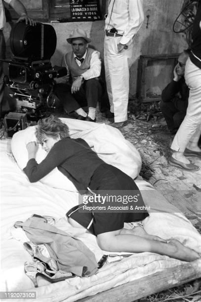 Italian actress Claudia Cardinale taking a break on the set of La Ragazza di Bube. Italy, 1963
