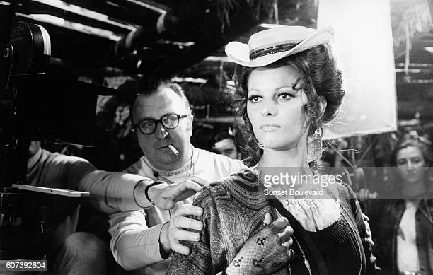 Italian actress Claudia Cardinale with director screenwriter and producer Sergio Leone on the set of his movie C'era una volta il West