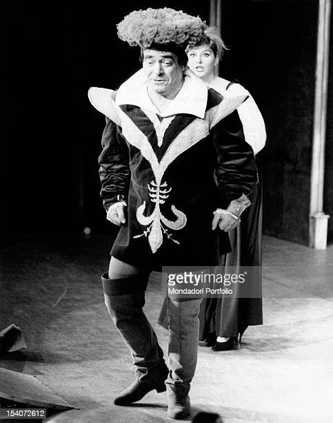 Italian actress Claudia Mori standing behind Italian actor Carlo Dapporto in the theatrical play Il Tiranno Milan October 1961