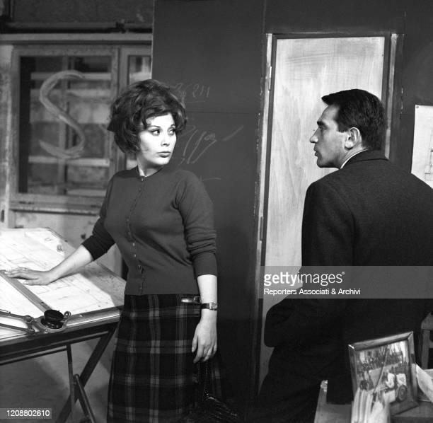 """Italian actress Daniela Rocca and Italian actor Walter Chiari in a scene from the film """"The Attic"""". 1962"""