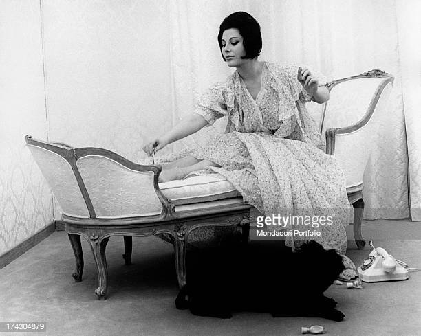 Italian actress Daniela Rocca darning a pair of stocking. She plays the role of a thrifty wife. 1962.