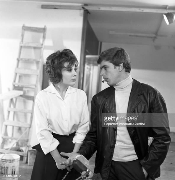 "Italian actress Daniela Rocca talking to Cuban-born American actor Tomas Milian on the set of the film ""The Attic"". 1962"