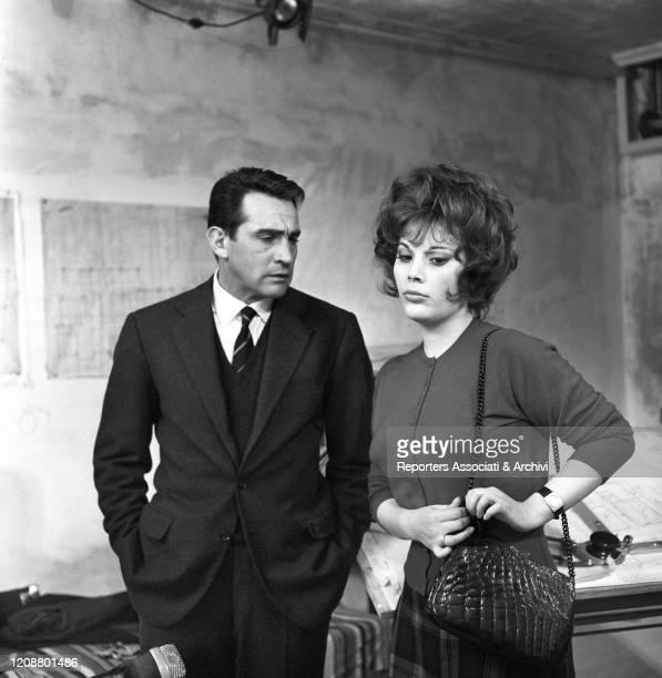 "Italian actress Daniela Rocca talking to Italian actor Walter Chiari on the set of the film ""The Attic"". 1962"