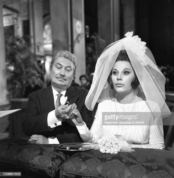 """Italian actress Daniela Rocca wearing a wedding dress on the set of the film """"The Attic"""". 1962"""