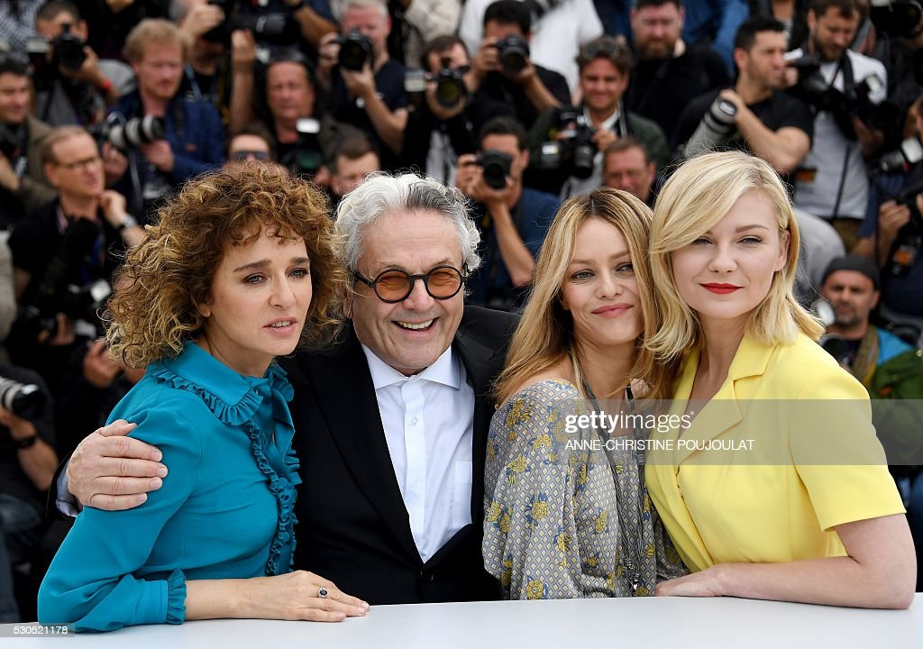Italian actress / director and member of the Jury Valeria Golino, Australian director and President of the Jury George Miller, French actress / singer and member of the Jury Vanessa Paradis and US actress and member of the Jury Kirsten Dunst pose on May 11, 2016 during a photocall ahead of the opening of the 69th Cannes Film Festival, southern France. / AFP / ANNE