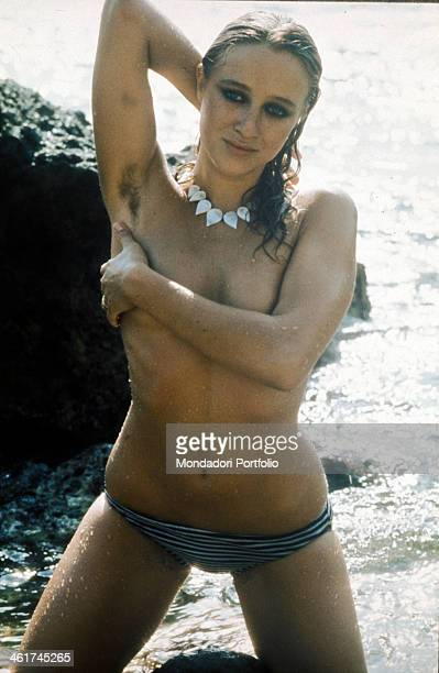 Italian actress director and scenarist Eleonora Giorgi posing in the sea covering her breast with her left arm Italy 1975