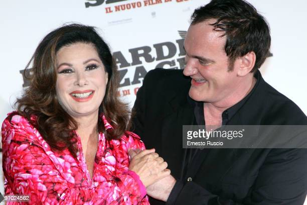 Italian actress Edwige Fenech and director Quentin Tarantino attend Inglourious Basterds Premiere at premiere at the Warner Cinema on September 21...