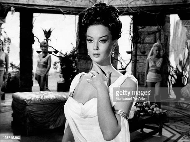 Italian actress Edy Vessel touching her neck in The Thief of Baghdad 1961