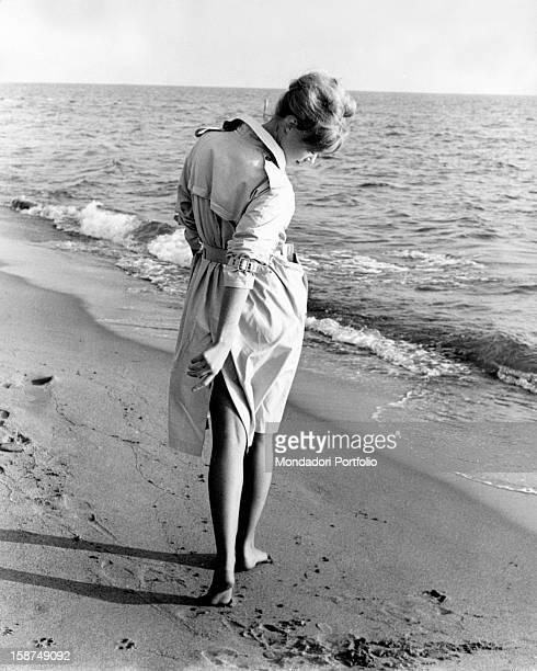 Italian actress Edy Vessel walking by the sea 1962