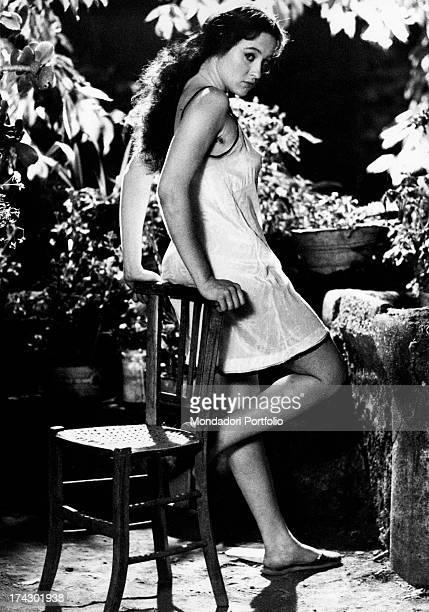 Italian actress Eleonora Giorgi posing leaning on a chair on the set of the film La sbandata Sant'Alfio 1974