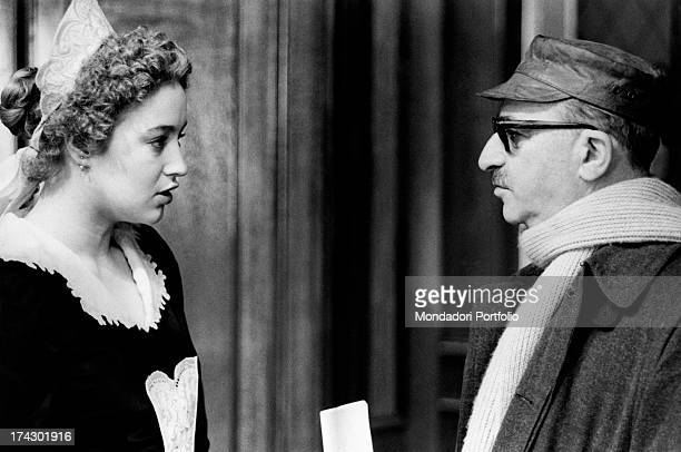 Italian actress Eleonora Giorgi talking with Italian director and scriptwriter Alberto Lattuada on the set of the film Dog's Heart. Rome, 1975.