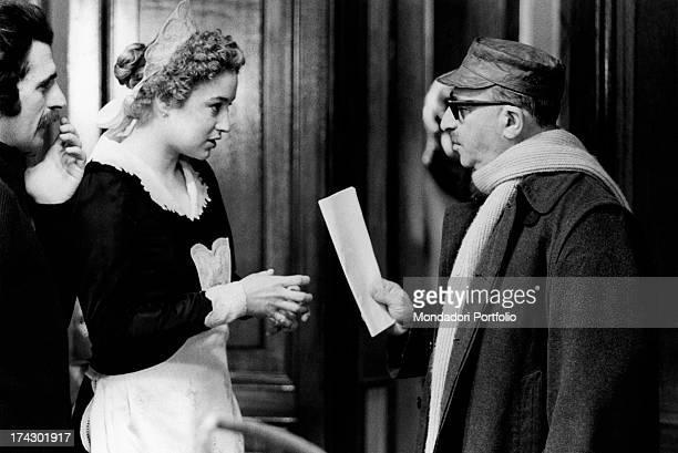 Italian actress Eleonora Giorgi talking with Italian director and scriptwriter Alberto Lattuada on the set of the film Dog's Heart Rome 1975