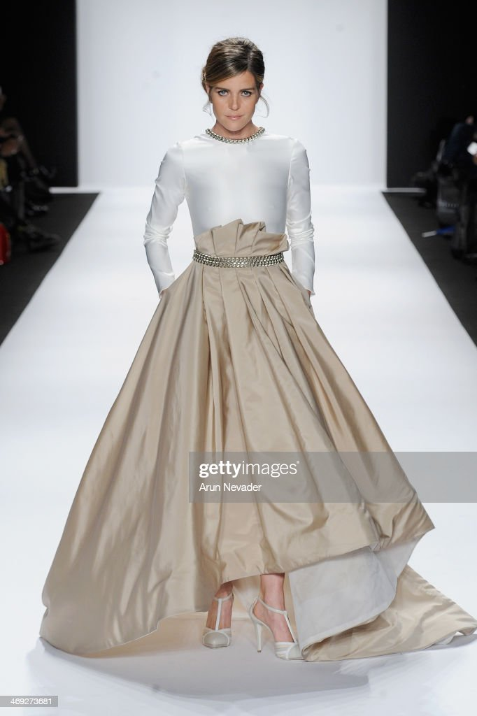 Italian actress Elisabetta Pellini walks the runway wearing designer Giada Curti at the FLT Moda + Art Hearts Fashion show presented by AIDS Healthcare Foundation during Mercedes-Benz Fashion Week Fall 2014 at The Theatre at Lincoln Center on February 13, 2014 in New York City.