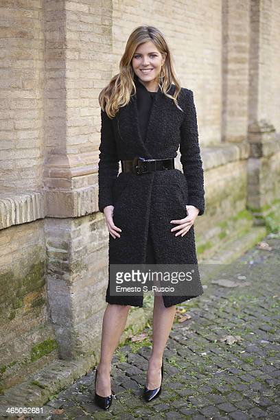 Italian actress Elisabetta Pellini wears Sarli coat on day 2 Rome Fashion Week Spring/Summer 2014 on January 23 2014 in Parisin Rome Italy