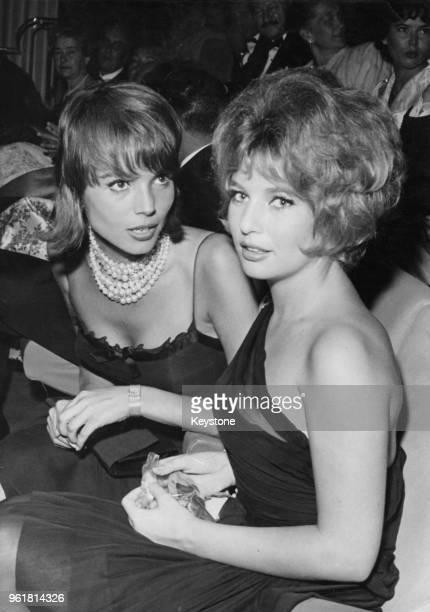 Italian actress Elsa Martinelli and Danish actress Annette Stroyberg at the premiere of the film 'Et Mourir de Plaisir' on the ChampsÉlysées in Paris...
