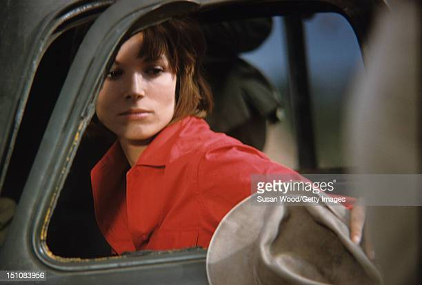 Italian actress Elsa Martinelli looks through the window of an open car door during the filming of 'Hatari' Tanzania 1962