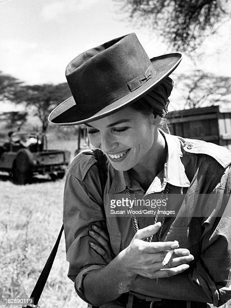 Italian actress Elsa Martinelli smokes a cigarette during a break in the filming of 'Hatari!' , Tanzania, 1962.