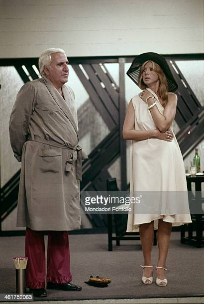 Italian actress Erna Schurer looking at Italian actor Adolfo Celi in the film Che notte quella notte Italy 1977