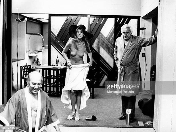Italian actress Erna Schurer naked and covering herself with a white dress with and Italian actors Adolfo Celi and Turi Ferro in the film Che notte...