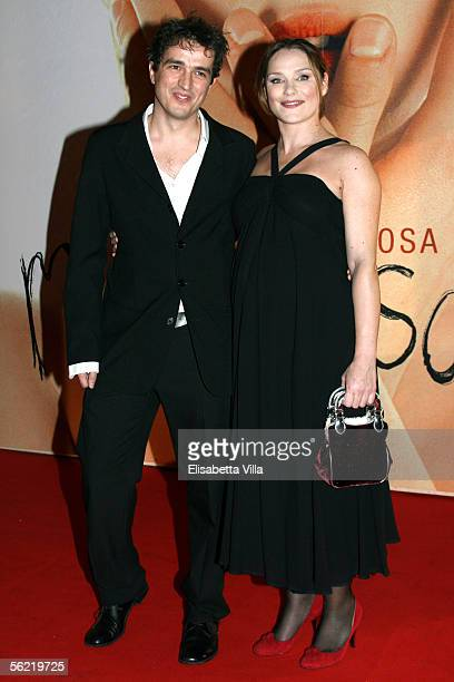 Italian actress Fabrizia Sacchi and her husband attend the Italian premiere for the new film Melissa P at the Cinema Warner Moderno on November 17...