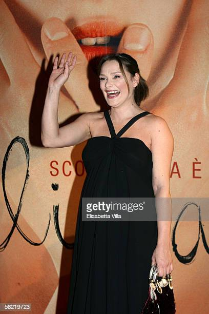 Italian actress Fabrizia Sacchi gestures as she attends the Italian premiere for the new film Melissa P at the Cinema Warner Moderno on November 17...