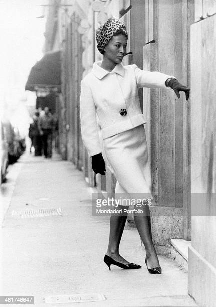 Italian actress Franca Bettoja famous Italian actor Ugo Tognazzi's future wife stands next to a front door and poses as a model wearing a white...