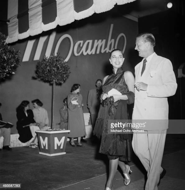 Italian actress Franca Faldini with Carleton Alsop arrive at Mocambo in Los Angeles, California.