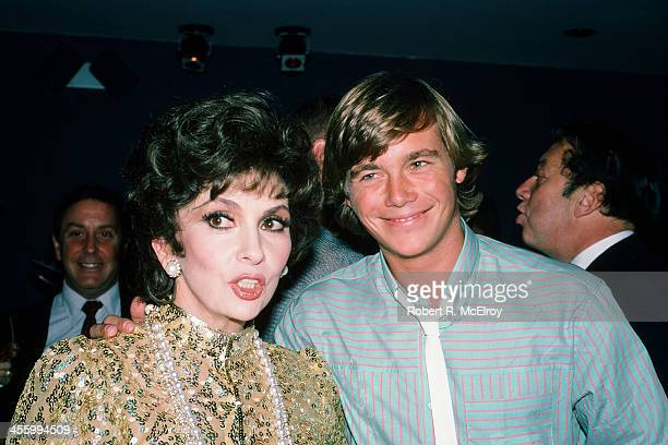 Italian actress Gina Lollobrigida and American actor Christopher Atkins pose together at an unspecified event New York New York 1984