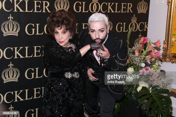 Italian actress Gina Lollobrigida and designer Harald Gloeoeckler attend the party to celebrate their 20 years of friendship on February 4 2014 in...
