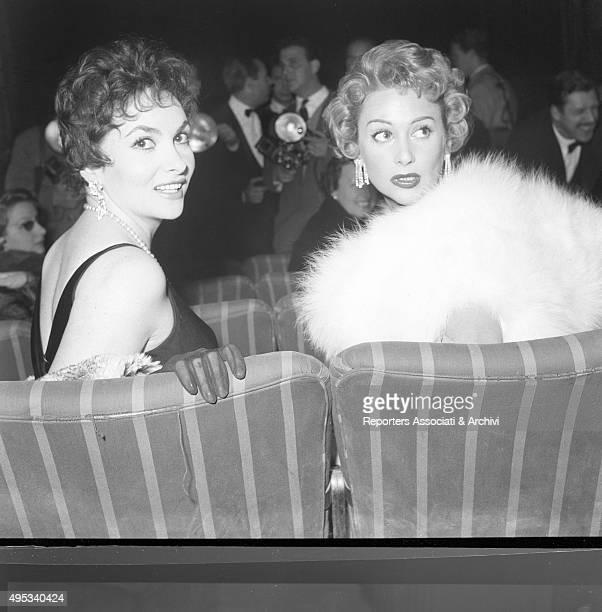 Italian actress Gina Lollobrigida and French actress Martine Carol attending an awarding ceremony 1956