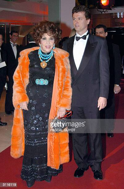 Italian actress Gina Lollobrigida and friend arrive 20 March 2004 to attend the annual Rose Ball or Bal de la Rose at the MonteCarlo Sporting Club in...