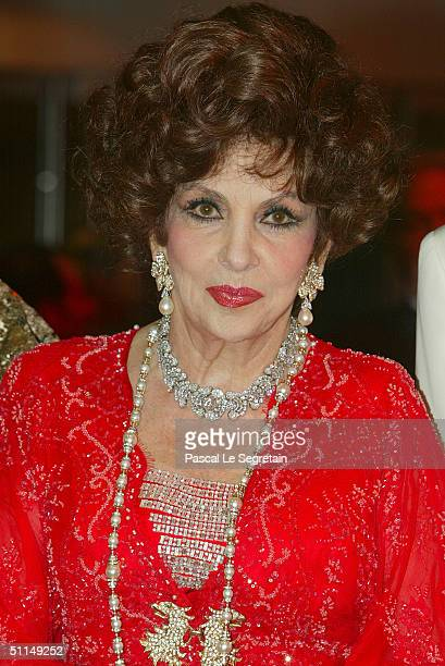 Italian actress Gina Lollobrigida arrives at the Monte Carlo Red Cross Ball 2004 held at the Salle des Etoiles of the Monaco Sporting Club on August...