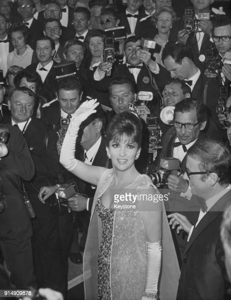 Italian actress Gina Lollobrigida arrives for the opening night of the Cannes Film Festival in France 27th April 1967 The film being shown is 'J'ai...