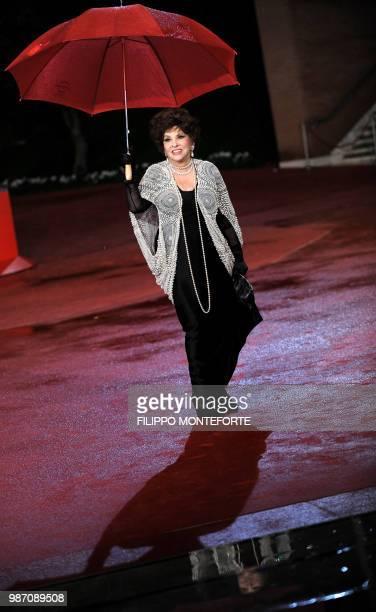 Italian actress Gina Lollobrigida arrives on the red carpet to present the documentary 'Gina Lollobrigida Un simbolo italiano nel mondo' at the Rome...