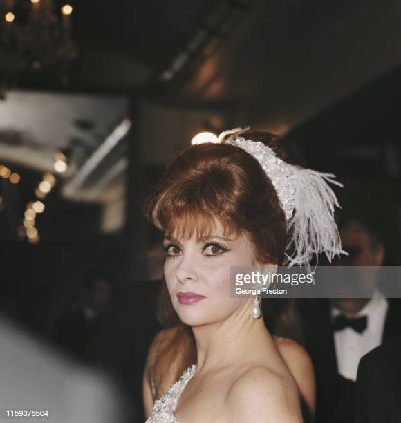 Italian actress Gina Lollobrigida attends the Royal Film Performance of the movie 'The Taming of the Shrew' at the Odeon Leicester Square London 27th...