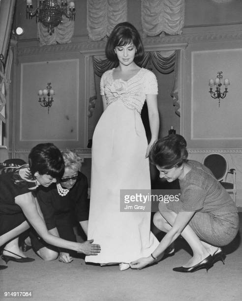 Italian actress Gina Lollobrigida being fitted with a new dress at the Christian Dior showroom in the West End of London 4th September 1963
