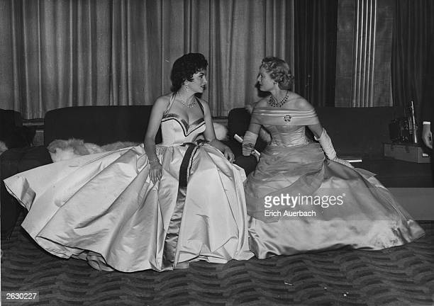 Italian actress, Gina Lollobrigida chats to British film star Anna Neagle after the Royal Film performance of 'To Catch a Thief' at the Odeon Theatre...