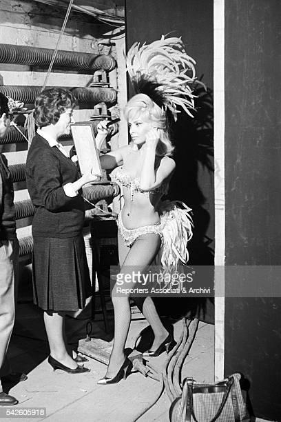 Italian actress Gina Lollobrigida combing her hair during a break on the set of in La bellezza di Ippolita 1962