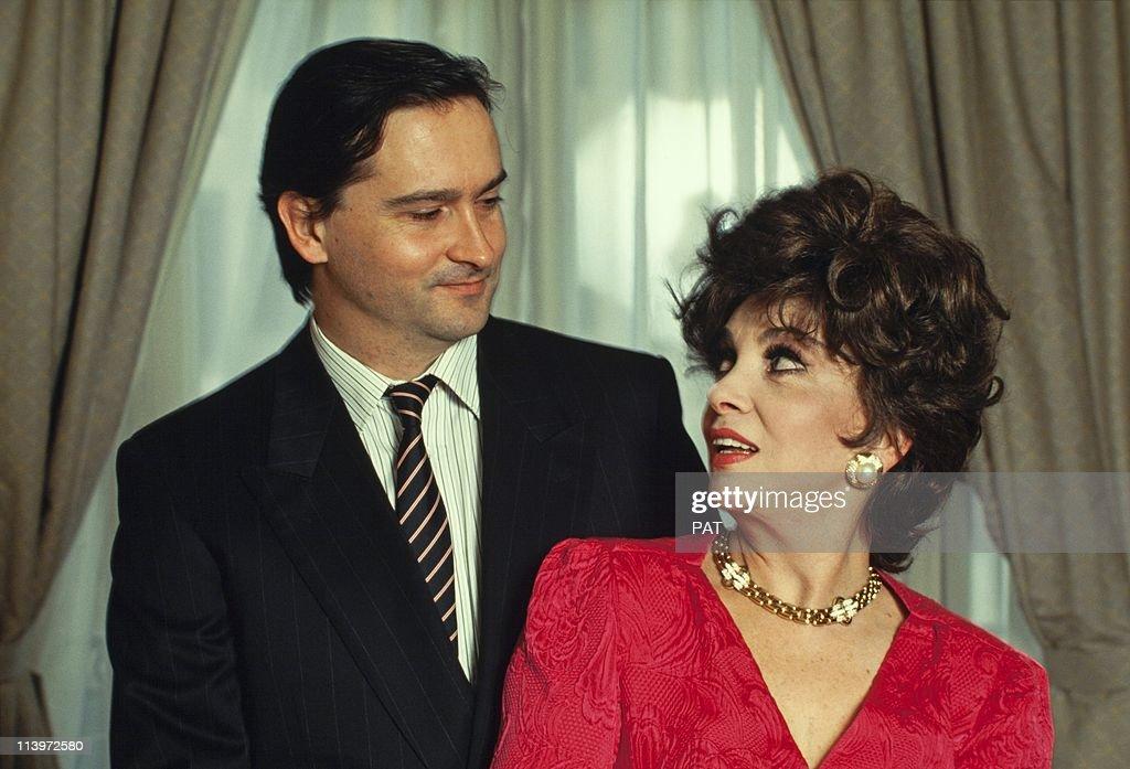 Italian Actress Gina Lollobrigida In France In February, 1994- Italian actress Gina Lollobrigida with her son Milko in February, 1993.