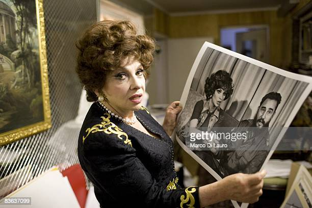 Italian actress Gina Lollobrigida is seen in her house as she show a photograph of her with Fidel Castro taken by Henry Kissinger on October 14 2008...
