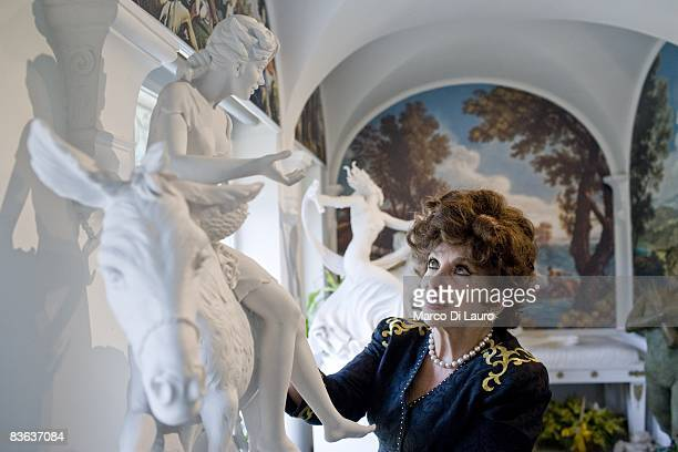 Italian actress Gina Lollobrigida is seen in her house next to her sculpture on October 14, 2008 in Rome, Italy.