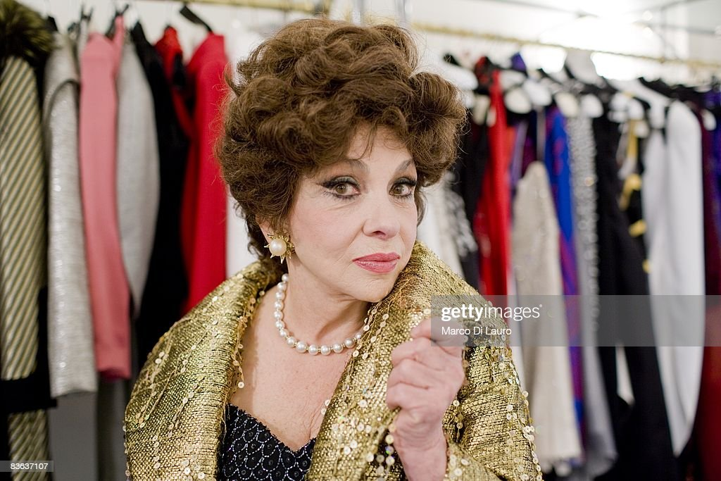 Italian actress Gina Lollobrigida is seen in the atelier of the Italian couturier Fausto Sarli as she tries on same dresses on October 14, 2008 in Rome, Italy.