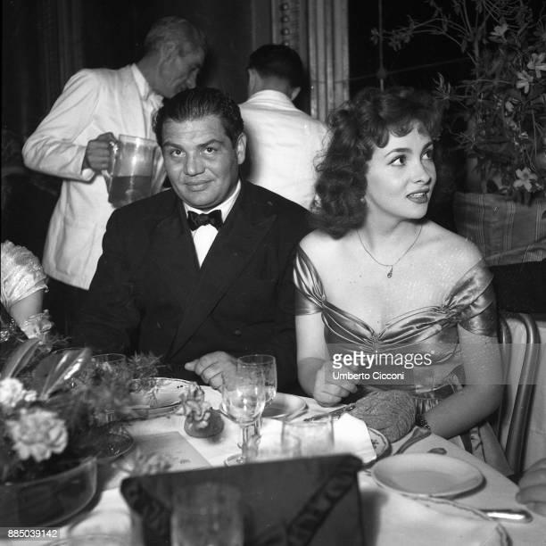 Italian actress Gina Lollobrigida is with actor Folco Lulli at the restaurant Rome 1952