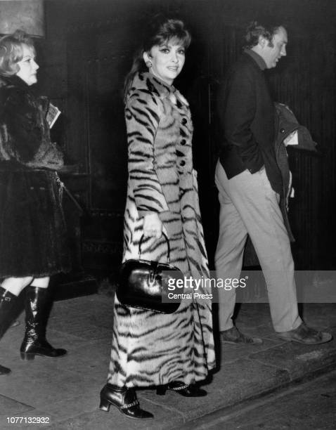 Italian actress Gina Lollobrigida leaves the Savoy Hotel in London for Elstree Studios 3rd January 1970 She is wearing a tiger fur coat estimated by...