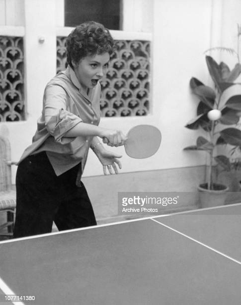 Italian actress Gina Lollobrigida playing table tennis during the making of the film 'Beat the Devil' circa 1953