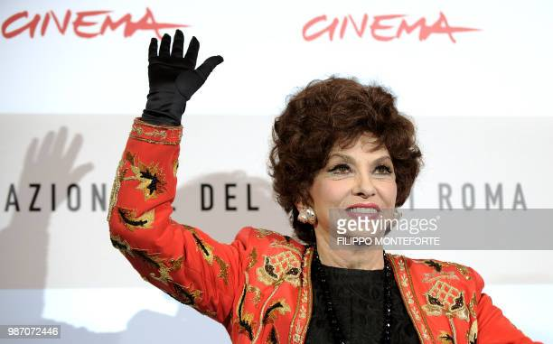 Italian actress Gina Lollobrigida waves during a photocall to present the documentary film 'Gina Lollobrigida Un simbolo italiano nel mondo' at the...